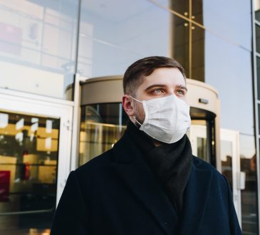 man wearing mask leaving store
