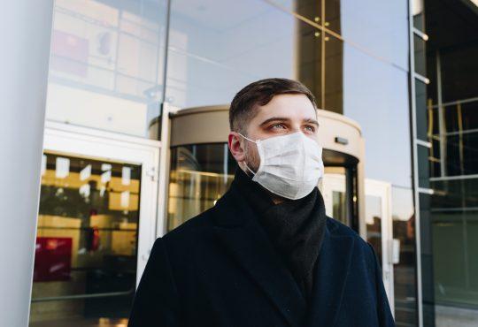 man wearing mask leaving store