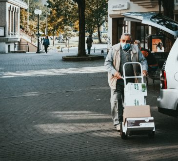 man pushing delivery cart