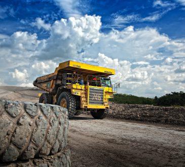 dump truck driving down dirt road