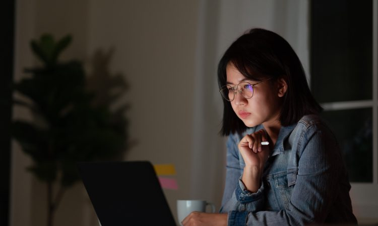 young woman working late at desk