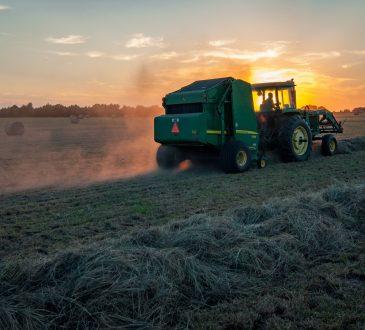 tractor mowing hay