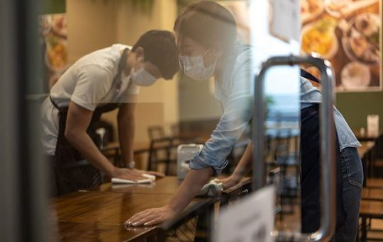 two young people working in cafe