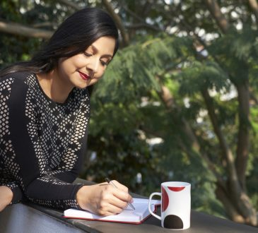 businesswoman writing in notebook outside