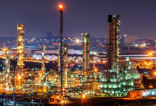 Oil refinery and​ industrial​ city​ After sunset