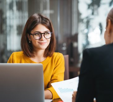 two women having meeting in office
