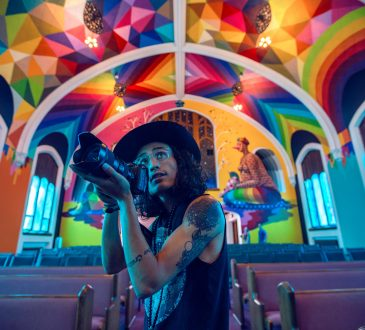 photographer inside colourful building