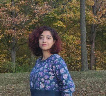 Student Shiva Montazeri standing in field
