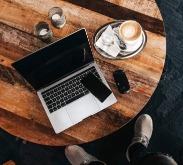 laptop on table with latte