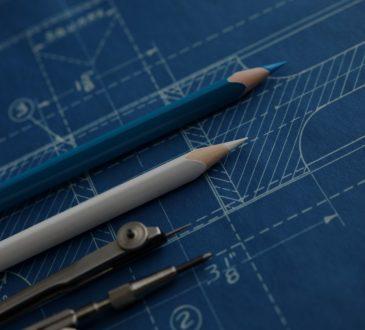 pencils lying on top of blueprint