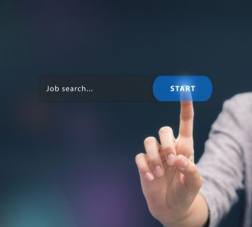 woman pressing start button for job search touch screen