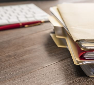 Stacked Files Paperwork on Desk