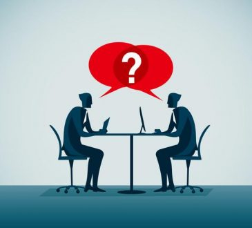 illustration of two people facing each other during interview over table with red question speech bubbles above them