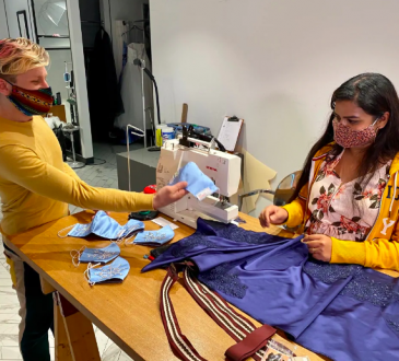 Soniagandhi Chinnasamy sews face masks at the Dean Renwick Design Studio in Regina under supervision of production manager Matthew Donnelly.