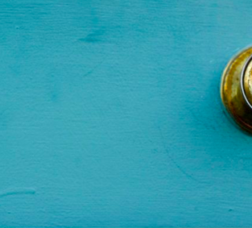 gold door handle on teal background