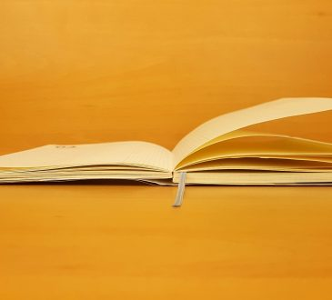 open book on yellow background