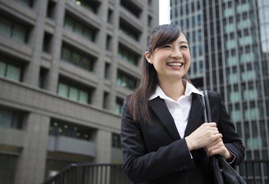 businesswoman walking outside