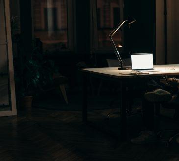 man working on laptop in the dark