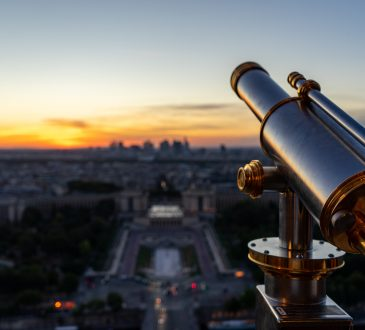 telescope looking over cityscape