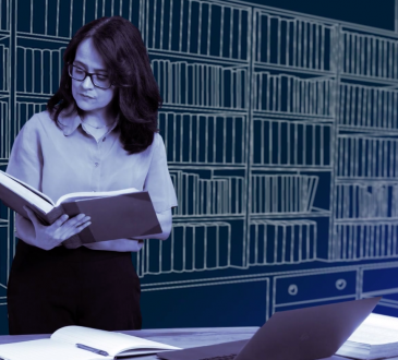 woman looking at book in library