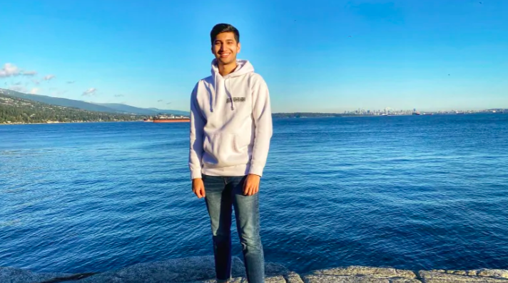student standing at vancouver waterfront