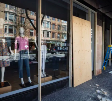 storefront with boarded-up windows