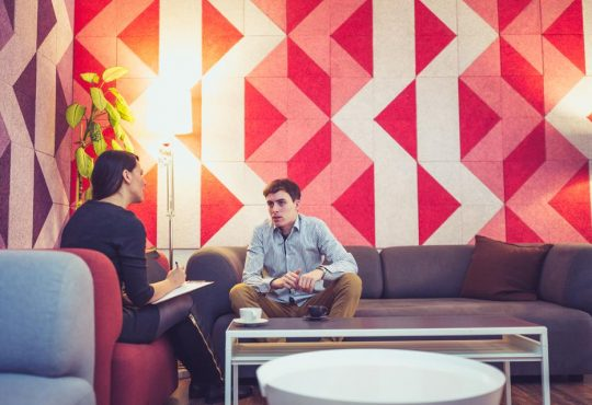 woman talking to student in counselling session