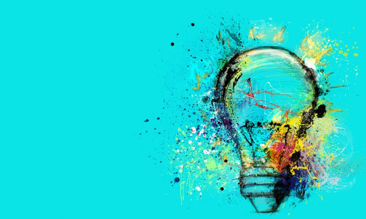 Big stylized light bulb on cyan background drawn with splashes of colored paint.