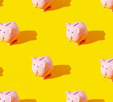 piggy banks on yellow background
