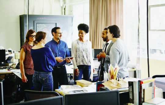 diverse co-workers in office