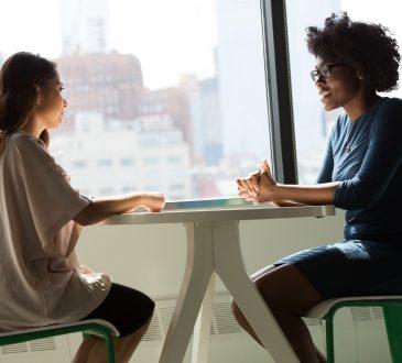 two women talking in office in interview