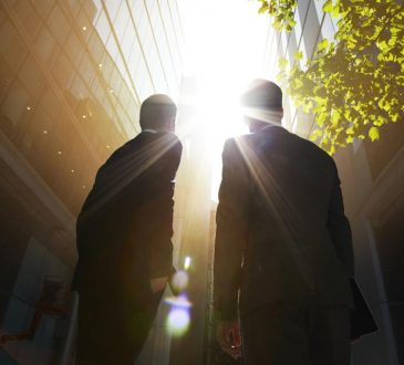 two businessmen on sunny street