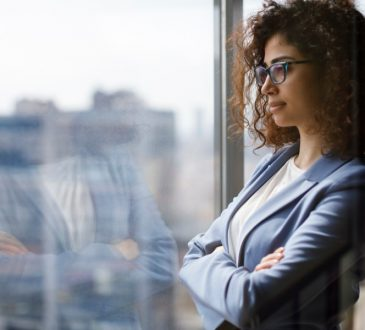 woman looking out office window