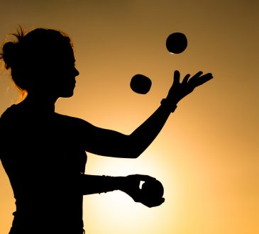 Silhouette of a Woman Juggling