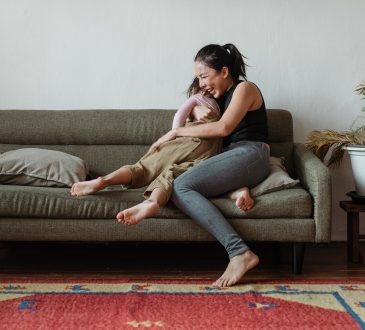 mom with child on couch