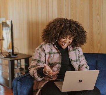 woman doing virtual interview on laptop