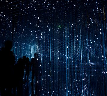 future concept image with people standing amid blue lights