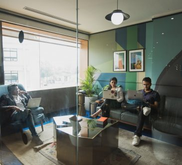 workers sitting on couches in modern office