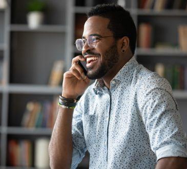 man having work phone call looking happy