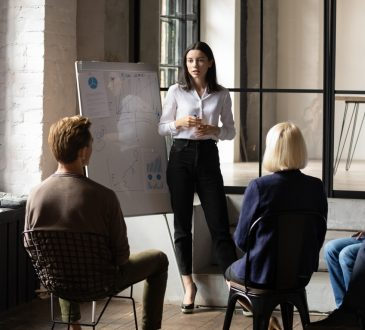 woman giving presentation to colleagues
