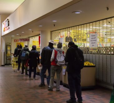 People are lining up to enter No Frills Store