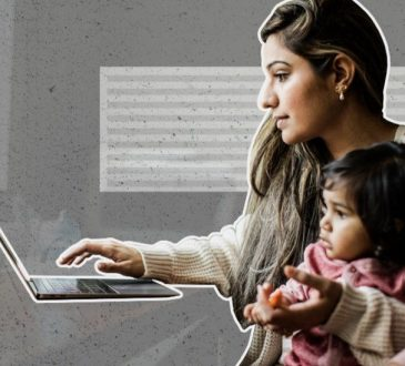 mom working on laptop with daughter in lap