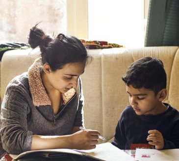 mom working with son on homework