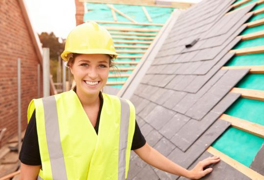 woman working on rooftop construction site