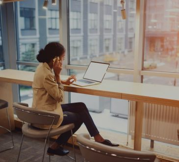 woman on laptop in coworking space