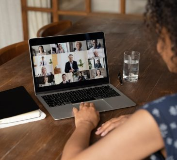 woman on video call at kitchen table