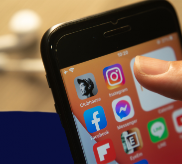 Clubhouse app among other social media icons on smartphone screen