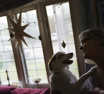 woman with dog in home