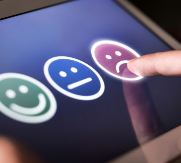 smiley, neutral and sad faces on screen for customer selection