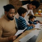 dad working while mom homeschools kids at kitchen table